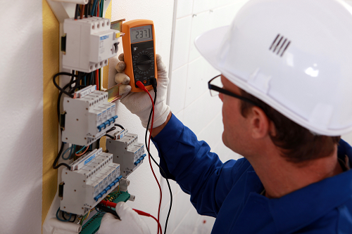 Electrician performing an electrical inspection